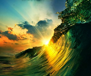 sun, waves, and ocean image