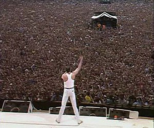 Queen, Freddie Mercury, and concert image