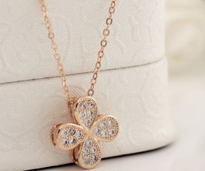 flower necklace, pendant necklace, and clover necklace image