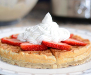 strawberries, waffle, and whipped cream image