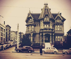 building, cars, and old image