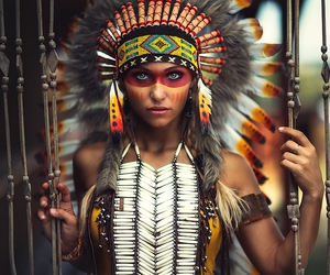 a girl in indian and costume and makeup image