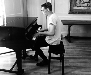 Jamie Campbell Bower, piano, and music image