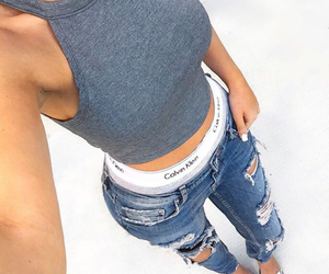 calvin klein underwear, silver heels, and blue ripped jeans image