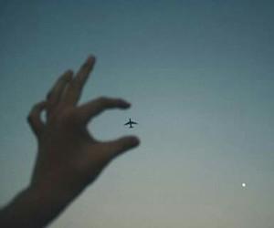 sky, airplane, and hand image