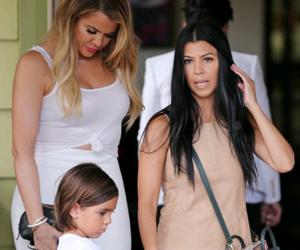 khloe kardashian, kourtney kardashian, and mason disick image