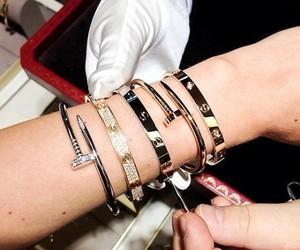 arm candy, bracelets, and diamonds image