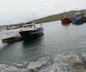 boat, ireland, and rocks image