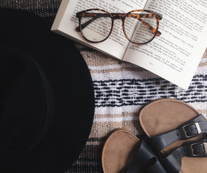 book, glasses, and hat image