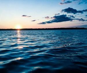 sea, sky, and sun image