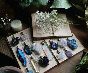crystal, book, and flowers image