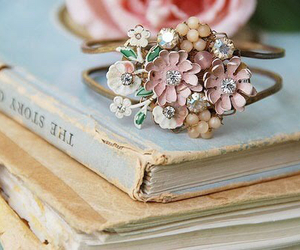 book, flowers, and ring image