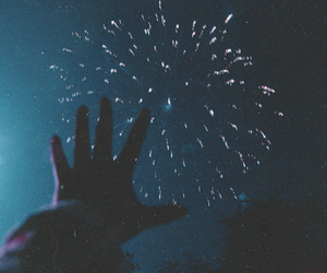 hand and fireworkd image