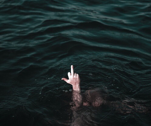 backpack, drowning, and middle finger image