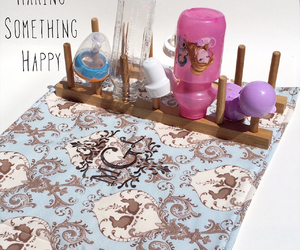 kitchen mat, baby bottles, and baby bottle drying mat image