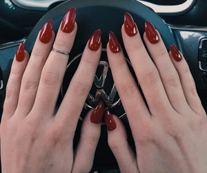 silver rings, red almond nails, and silver mid rings image