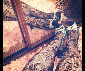 leopard print, iron fist, and photography image
