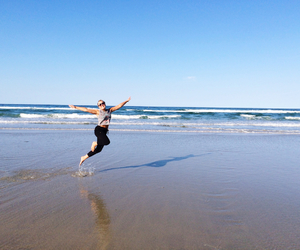 beach, water, and jumping image