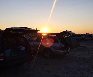 beach, cars, and sun set image