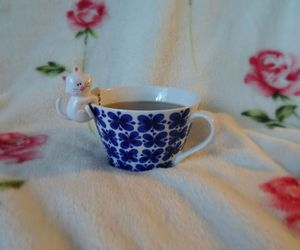 cat, tea, and flowers image