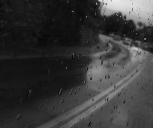 black and white, rain, and road image
