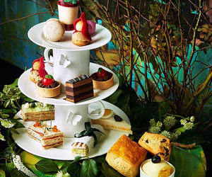 cakes, tea, and croissant image