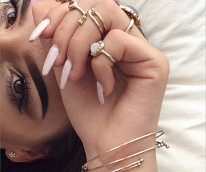 bracelet, hand, and mascara image