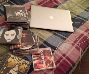 cds, macbook, and apple products image