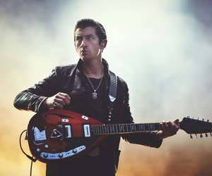 alex turner, arctic monkeys, and guitar image