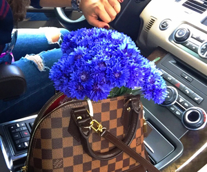 flowers and Louis Vuitton image