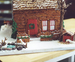 ginger bread house, pretzels, and edible art image
