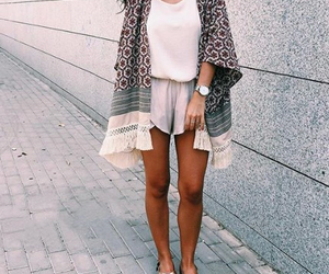 shorts and tribal sweater image