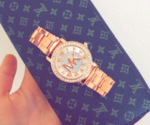 Michael Kors, wallet, and watch image
