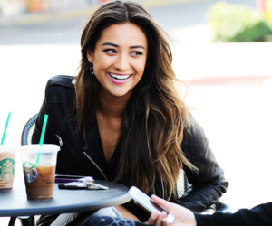 shay mitchell, emily fields, and starbucks image