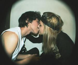 boy and girl, couple, and kiss image