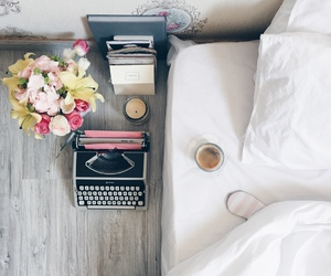 bed, flowers, and typewriter image