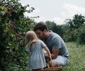 father, daugther, and berries image
