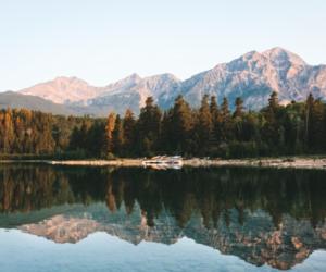 lake, mountains, and tree image