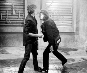 fight, sucker punch, and Keith Richards image