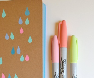 notebook, sharpies, and stationary image