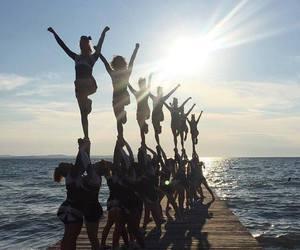 cheer, cheerleading, and sunset image