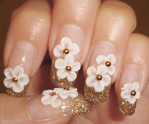 nails, flowers, and gold image