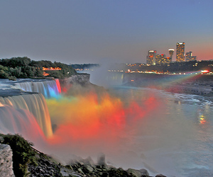waterfall, rainbow, and city image