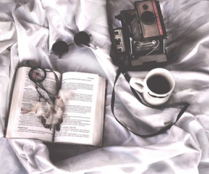 bed, book, and camera image