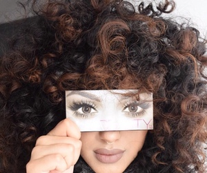 curly hair and eyes image