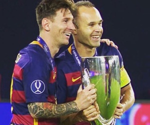 leo messi, fc barcelona, and andres iniesta image