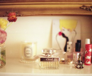 candle, flowers, and perfume image