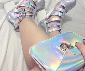 clutch, shoes, and holographic image