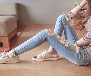 fashion, floor, and ripped jeans image