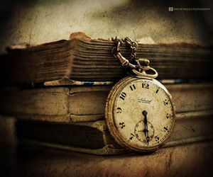 books, stopwatch, and ore image